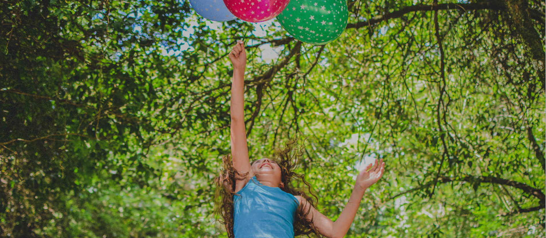 child with ballons